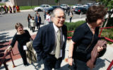Nobel Laureate Adolfo Perez Esquivel, of Argentina, center, arrives at the Newman Center on the DU...