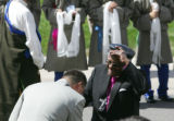 Archbishop Desmond Tutu doffs his cap as he greets supporters at the Newman Center on the DU...