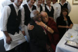 DLM00722   Nobel Peace Prize Laureates the Dalai Lama, right, playfully chokes the Archbishop...