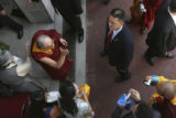 the Dali Lama enters the center after a short trip from his car under very heavy security but...