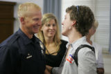 JPM0174 Denver Police officer Jack Bishop, left, talks to juror Kelli Bee (cq) after jurors talked...