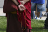 A monk holds prayer beads moments prior to the arrival of the Dali Lama. PeaceJam, University of...