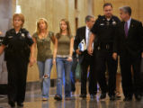 Kelly Young (left, in green), the widow of detective Donald Young, and their daughter Kourtney...