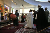 Men join in dance and song that was part of an Ethiopian service Sunday morning October 1, 2006 in...