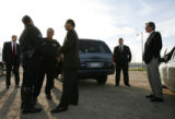 MJM504 Peace Jam co-founder Ivan Suvanjieff (cq), right, stands by as secret service and police...