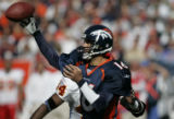 Denver Broncos Jake Plummer throw a pass in the fourth quarter against the Kansas City Chief at...