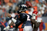 Denver Broncos Jake  Plummer throws a pass intended for Rod Smith and was intercepted by  Kansas...