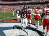 Denver Bronco quarter back Jake Plummer leaves the field after the coin toss before taking on the ...