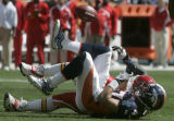 Denver Bronco safety John Lynch recovers a fumbled by Nick Ferguson who stripped the ball fom...