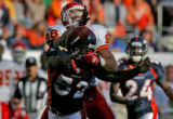 Denver Bronco linebacker Ian Gold breaks up a pass play to Kansas City Chief tight end Tony...