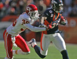 Denver Bronco wide reciever Javon Walker,right, slips past Kansas City Chief cornerback Lenny...