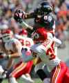 Denver Bronco wide reciever Rod Smith, top, leaps over Kansas City Chief cornerback Lenny Walls,...