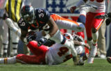 Denver Bronco full back Kyle Johnson, left, gets 15 yards as he gets past Kansas City Chief safety...