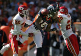 (JPM1126) Kansas City Chiefs cornerback Lenny Walls, #35, and Sammy Knight, right, collide with...