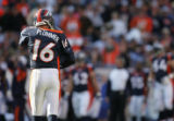 (JPM0797) Denver Broncos quarterback Jake Plummer, #16, walks to the bench after the offense could...