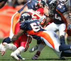 (JPM0091) Denver Broncos D.J. Williams, #55, John Lynch, #47, and Champ Bailey, #24, gang tackle...