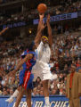 Denver, Colo., photo taken November 12, 2004-Denver Nuggets forward Carmelo Anthony, right, shoots...