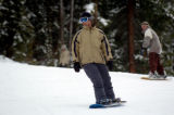 (BRECKENRIDGE, Co., SHOT 11/12/2004) Snowboarders make their way down to the base of Peak 9 and...