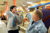 [Denver, CO - Shot on: 1/9/05]  Jimmy Hernandez,11 gives a high five to Dan Johnson after bowling...