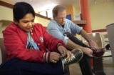 [Denver, CO - Shot on: 1/9/05]  Jimmy Hernandez, 11 and Dan Johnson tie their shoes as they enjoy...