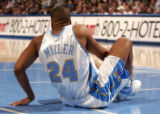 (Denver, CO., January 9, 2004) Andre Miller goes down with an ankle injury in the second half of...