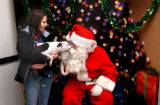 Thorton, Colo., photo taken December 5, 2004- Jen Newell (left) holds her dog Otis a Boston...