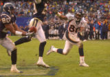 [(Denver, CA, Shot on: 12/5/04)] Denver Broncos Rod Smith reaches back but can't get the ball...