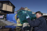 (Aurora, Colo., November 19, 2004)  Aurora fire investigators carry out a burned chair that the...