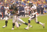 [(Denver, CA, Shot on: 12/5/04)] San Diego Chargers Antonio Gates gets tackled by Kenoy Kennedy(in...