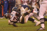 [(Denver, CA, Shot on: 12/5/04)] Denver Broncos Rueben Droughns gets tackled by San Diego Chargers...