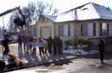 (Arvada, Colo., November 21, 2004) The Medeiros family and Correa family point to the crowd as...