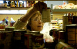 (LAKEWOOD Colo., December 6, 2004) Sonya Noyes works on filling a food order for 8 people at the...