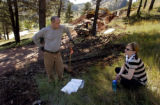 (BOULDER, Colo., October 2, 2004)   Tina and Christopher Herr wait for contractor James Casanova...