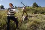(BOULDER, Colo., October 2, 2004)   Tina and Christopher Herr plant trees, with the help of...