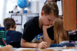 (WESTMINSTER, Colo., December 7, 2004)  Third grader, Preston Riley,9, works on math problems...