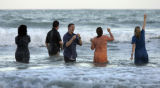 (1/25/05, Pondicherry, India)  Some of the crew got in the ocean to celebrate their last day for...