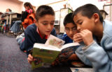 (DENVER, CO. DECEMBER 8, 2004) Barney Ford Elementary School fourth grader Jose Trejo, 9, reads a...
