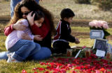 (Wheatridge, Colorado.  11/14/2004) At the Mount Olivet Cemetary family members gather at the...