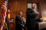 (DENVER, CO. DECEMBER 9, 2004) U.S. Attorney of Colorado John Suthers, flanked by Governor Bill...