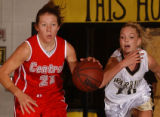 Littleton, Colo., photo taken Dec. 10, 2004-Arapahoe's Allie Hastings (right white #10) swipes at...