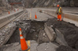 Denver, Colo., photo taken November 26, 2004-CDOT worker Adam Padilla examins a crater formed in...