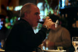 (DENVER, Co., SHOT 11/22/2004) Bill Neely of Denver sits at the bar and sips a glass of wine while...