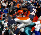 (DENVER, CO., DECEMBER 12, 2004)  Denver Broncos #28, Kenoy Kennedy, right, collides with   Miami...