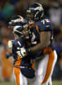 (DENVER, CO., DECEMBER 12, 2004)  Denver Broncos kicker, #1, Jason Elam, left, celebrates his game...