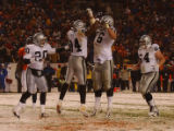 Denver, Colo., photo taken November 28, 2004-  Okland RaIders celebrates going ahead 25-24 after...