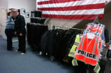 (LONE TREE Colo., November 16, 2004) Todd Pachello gets fitted for his police uniform by Jan...