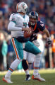 (Denver, Colorado, Dec. 12, 2004) John Lynch pressures Miami quarterback A.J. Feeley in the 2nd...