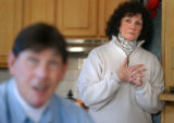 (EVERGREEN, Colo., Nov. 30, 2004) Linda Heslin (right) listens to her husband, Geno, speak about...