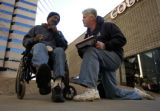 (Denver, Colo., 11/30/ 2004)  Across from the Samaritan Shelter and Rescue Mission homeless gather...
