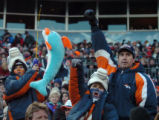 (DENVER, CO., DECEMBER 12, 2004)  Denver Broncos fans, John, 9, James 12, and father Brett...